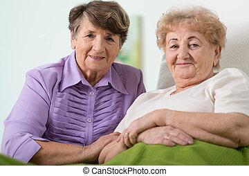 Elderly friends - Portrait of two happy elderly friends