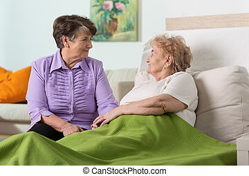 Friends visit - Older sick woman in hospital and her friends...