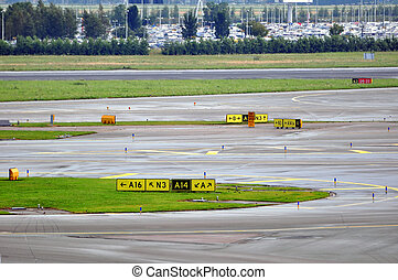 Airport runway and taxiways - Runway and taxiways sign at...