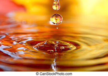 Golden drops - Drops of pure clear water with colored...