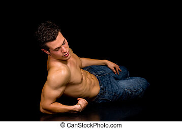 Body Builder, artistic pose - Young attractive male body...