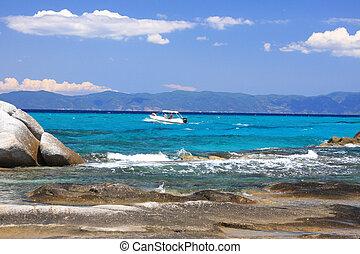 Portokali beach, Halkidiki, Greece with Athos mount on...