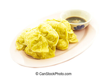 Gyoza - Dim sum : Gyoza, it made wrappers and meat in plate...