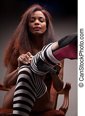 sexy model wearing striped stockings (heels in focus)
