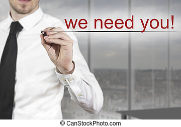 businessman writing we need you - businessman in office...
