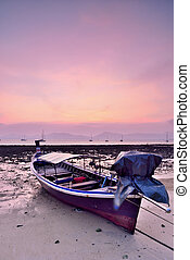 Longtail Boat - Traditional Thai Longtail Boat at Sunset