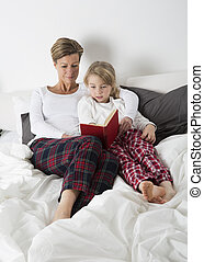 Mother and Daughter Reading - Mother and Daughter reading a...