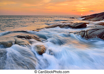 seascapes -  sea wave on the beach at sunset time