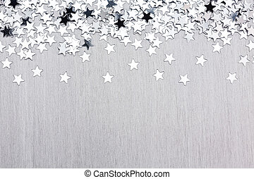 Star confetti on silver metal background