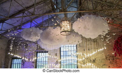 Hall for wedding ceremony decorated with flowers