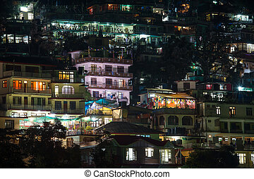 Houses at Himalaya mountains at night in Dharamsala, India