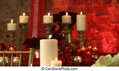 Lighted candles and red roses as interior decor - View of...