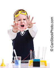 Young scientist - Young boy performing chemistry experiments...