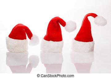 Three Christmas hats Santa row