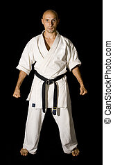Karateka men fighting - The serious karateka men is fighting