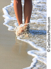 girl walking in water - nice legs of a pretty girl walking...