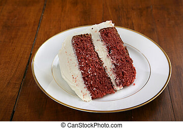 slice of red velvet cake on a china plate