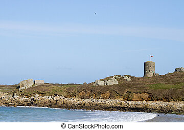 loophole towers in Guernsey that guard the coastline. - The...