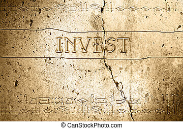 invest - word invest on wall with egyptian alphabet made in...