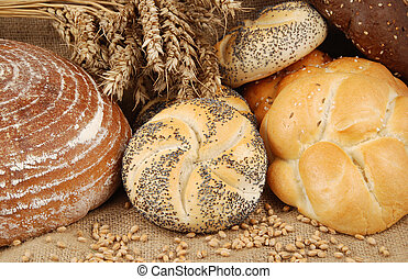 Baked goods - Various fresh baked goods with wheat grain and...