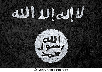 Islamic State of Iraq and the Levant flag on the concrete...