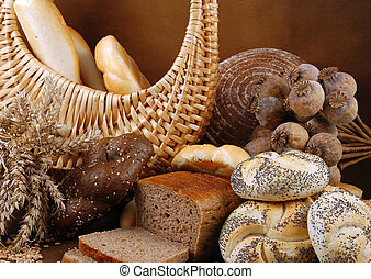 Bread still-life - Various fresh baked goods with a basket,...