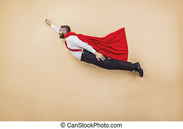 Super manager - Manager in a superman pose wearing a red...