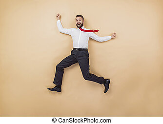 Super manager - Happy manager jumping high in a victorious...