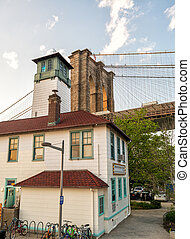 Brooklyn Bridge as seen from Brooklyn streets at sunset time