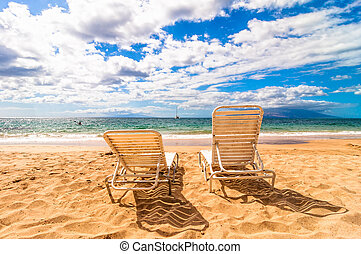 empty deckchairs on Makena Beach in Maui, Hawaii - day view...