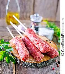 Ljulja-kebab - raw Ljulja-kebab and fresh parsley on board