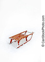 Wooden Sledge in the snow as copy space