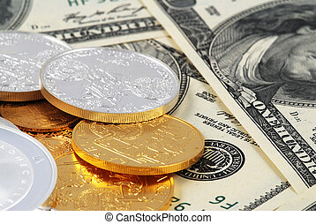 Dollars and coins - Dollar banknotes with a heap of golden...
