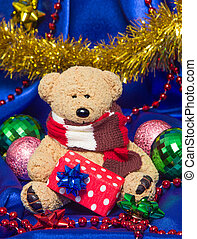 Charming small teddy bear with Christmas gift - Charming...