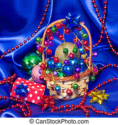 Wicker basket with Christmas decorations and gift - Wicker...