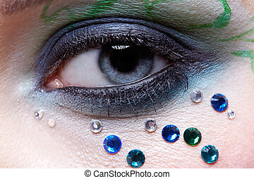 girl\'s eye zone bodyart - close up of european girl\'s eye...
