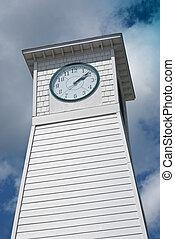 Clock Tower - Clock tower set against a cloudy blue sky