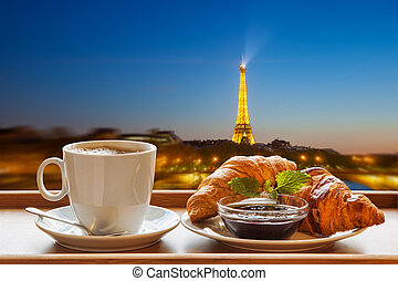 Coffee with croissants against Eiffel Tower in Paris, France...