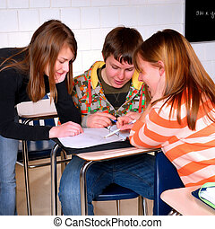 Students Working Together - Students in a Classroom Working...