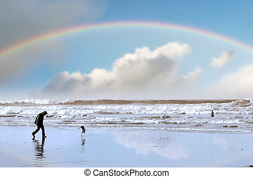 one man and his dog on Ballybunion beach county Kerry...