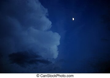 half moon glows on the face of the cloud