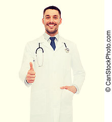 smiling doctor with stethoscope showing thumbs up -...