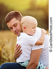 Father and son hugging - Young father and son enjoying life...
