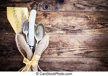 Old knife, spoon and fork decoratively presented. - Old...
