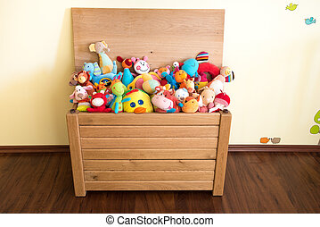 Toy Box full of soft toys in a childs bedroom