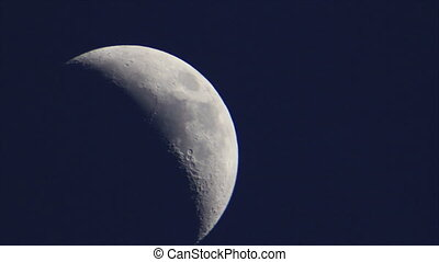 High resolutions moon-rise - Half moon on dark blue sky...