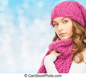 young woman in winter clothes - happiness, winter holidays,...