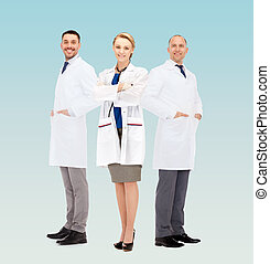group of smiling doctors in white coats - healthcare,...