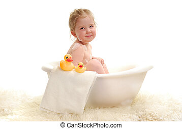 Bathtime - A young girl with bubbles in bathtub.