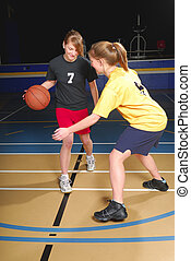Female Basketball Players - Two female basketball players...